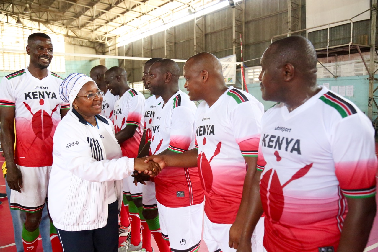 Former First Lady, Hon Salma Kikwete is introduced to the players from the Parliament of Kenya by the volleyball captain, Hon Dan Wanyama
