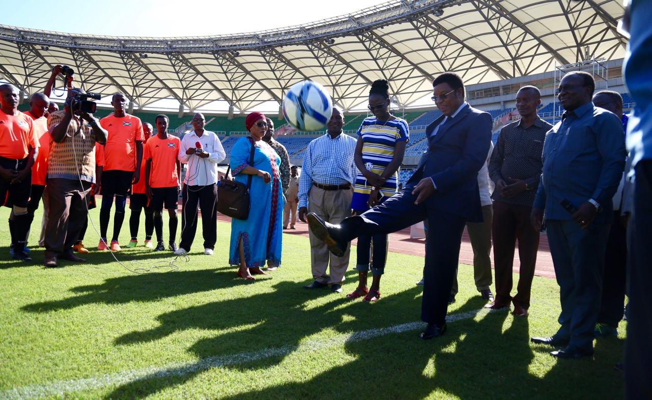 The Prime Minister of the United Republic of Tanzania, Rt Hon Kassim Majaliwa signifies the commencement of the soccer match featuring Burundi and Tanzania.  Tanzania won 3-1
