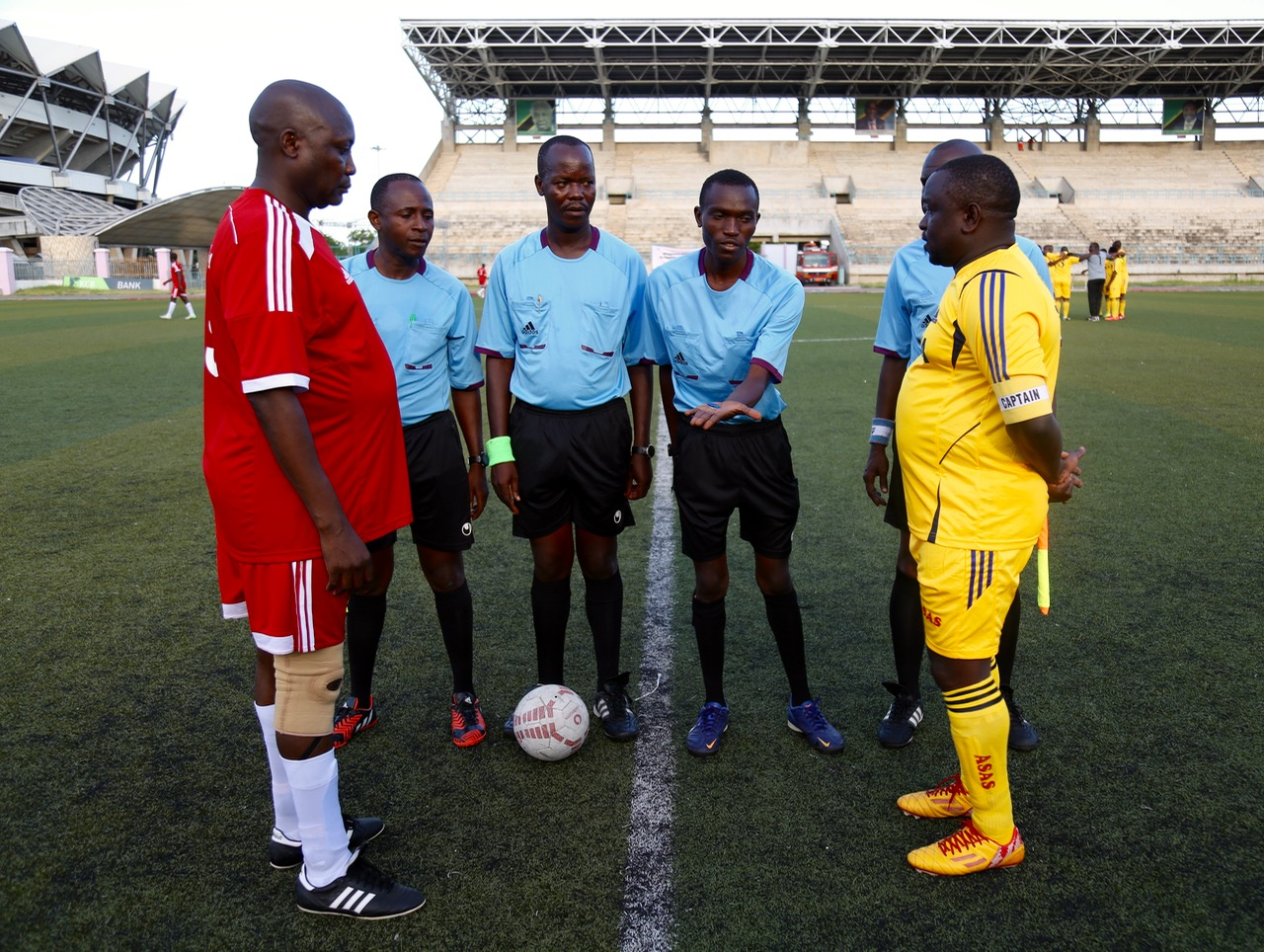 EALA Captain, Kenneth Madete (left) and the Captain of the Bunge Sports Club, Tanzania, Hon Gibson Ole Meseyiek look on as the referee tosses a coin at the start of the match.  EALA beat Parliament of Tanzania 6-0 in an entertaining match