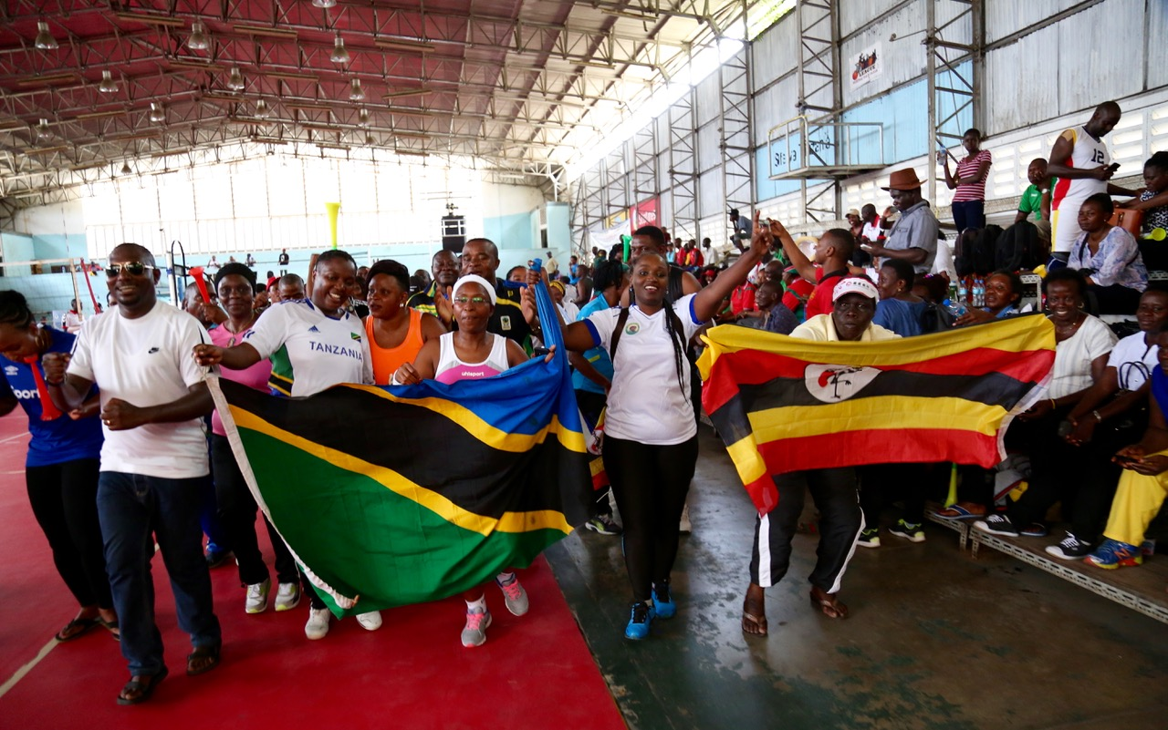 POMP AND COLOUR: Legislators and fans in a joyous mood at the Indoor Stadium in Dar
