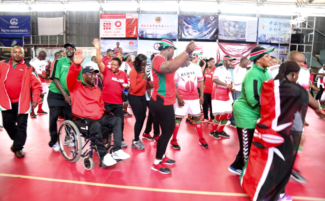 Team Kenya celebrates at the Indoor stadium after winning yesterday's volleyball matches
