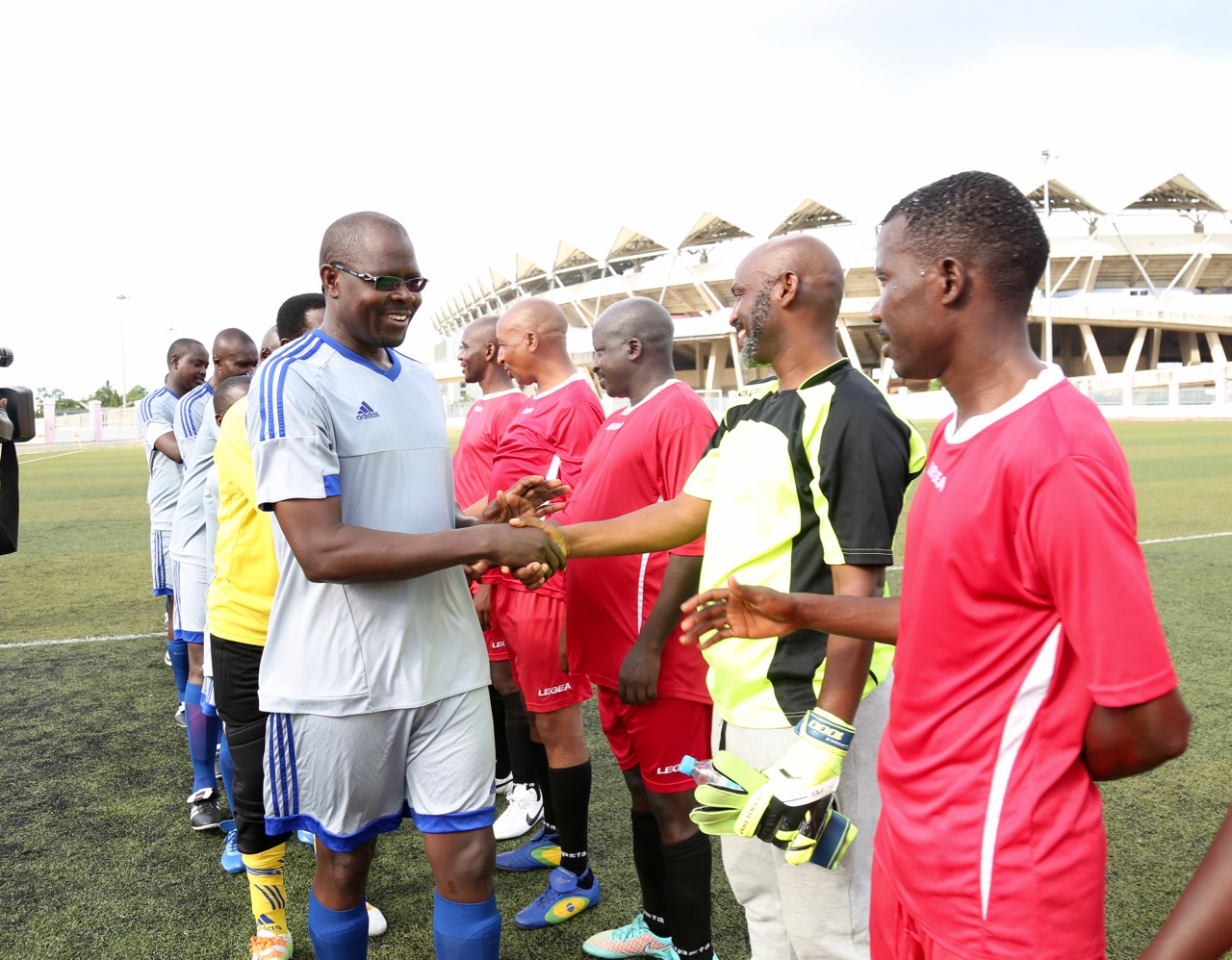 EALA's Hon Julius Wandera Maganda shakes hands with the Burundi Goalkeeper, Hon Ibrahim Uwizeye moments before the game kicked off.  EALA won 7-1