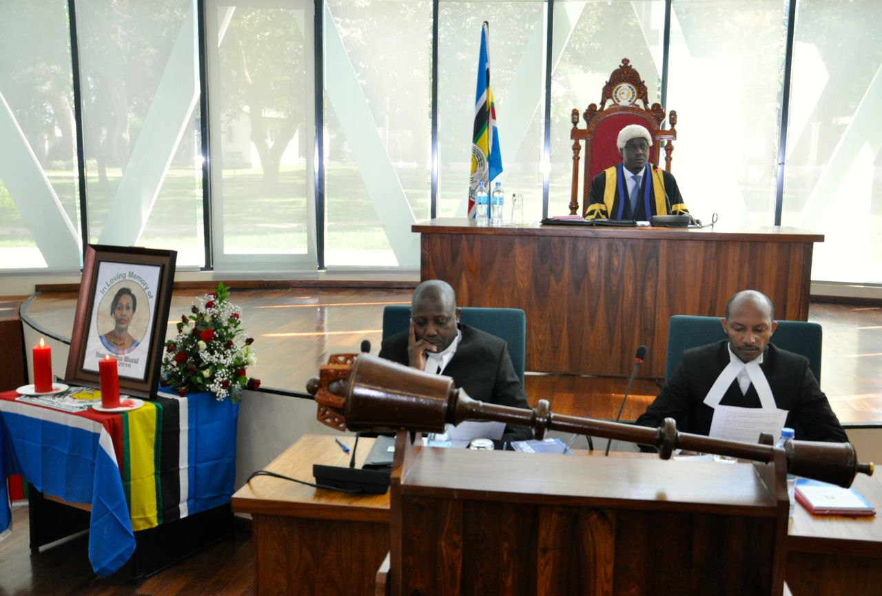 The Speaker, Rt Hon Daniel F. Kidega communicates to the Assembly at the start of the Special Sitting. In the foreground is Clerk, Kenneth Madete (left) and Senior Clerk Assistant, Stephen Mugume