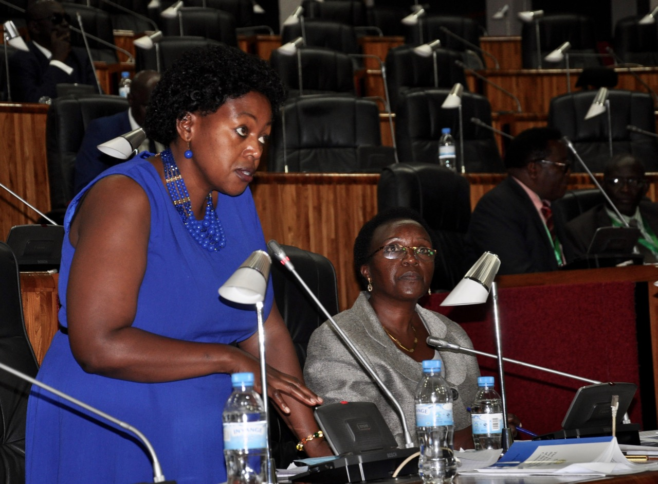Hon Nancy Abisai, the mover of the Bill on Gender Development and Equality speaks as Hon Dr Odette Nyiramilimo looks on