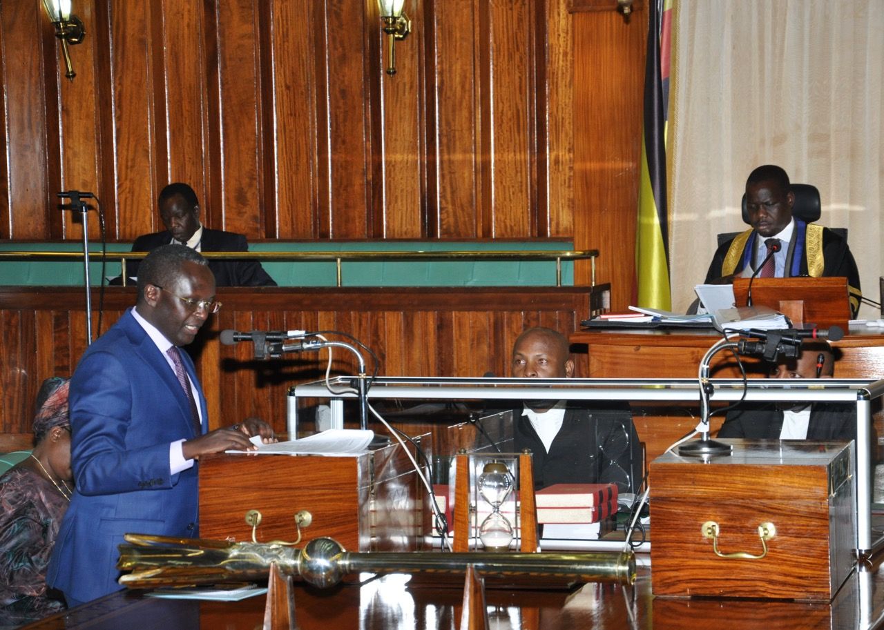 Hon Martin Ngoga, presents the Report of the Committee on Legal Rules and Privileges