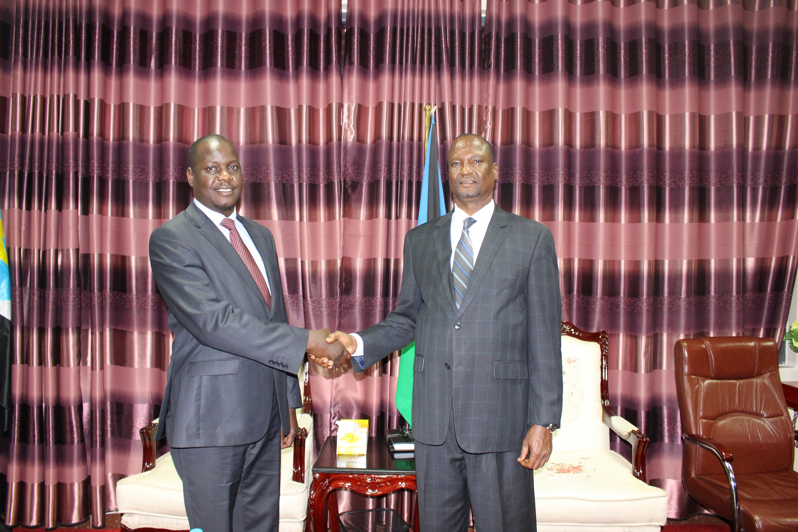 The 1st Vice President of the Republic of South Sudan, H.E. Taban Deng Gai shakes hands with the EALA Speaker, Rt Hon Daniel F. Kidega after the meeting