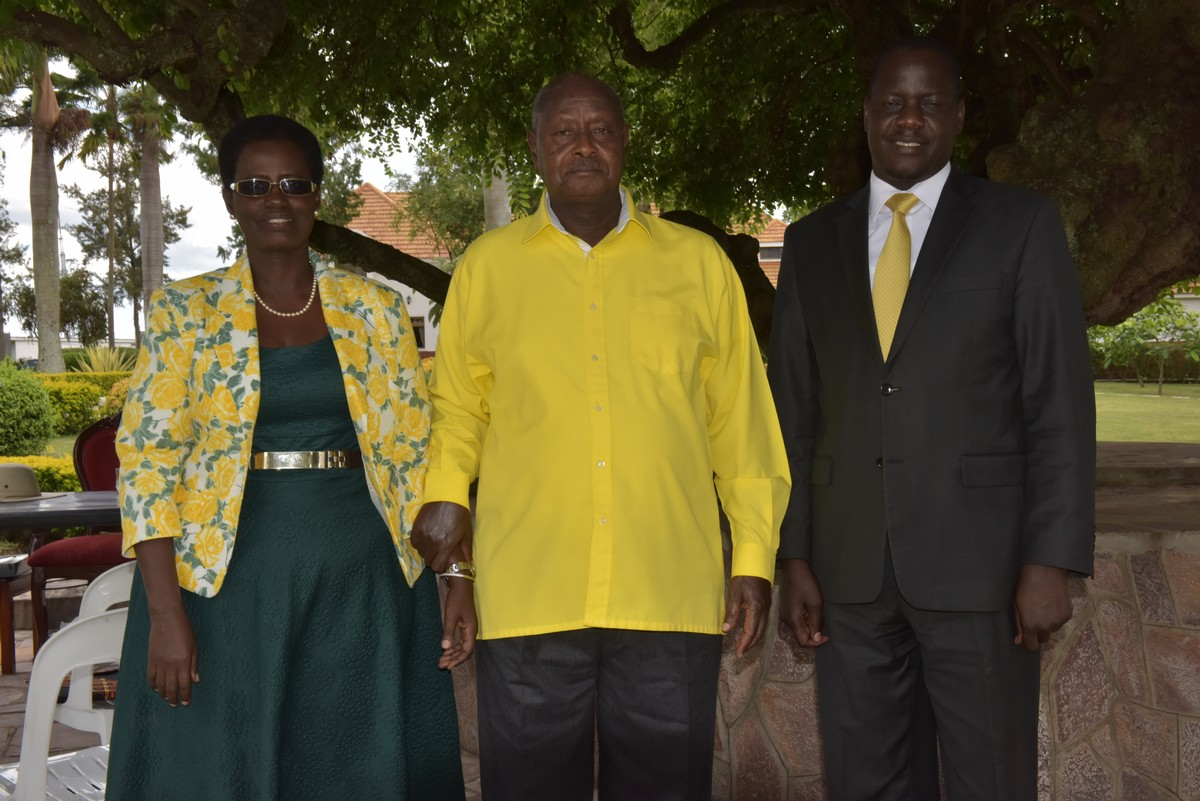 President Yoweri Museveni poses for a picture with Rt Hon Daniel F. Kidega (right). On left is Mrs Winifred Kaliba, staff of EALA